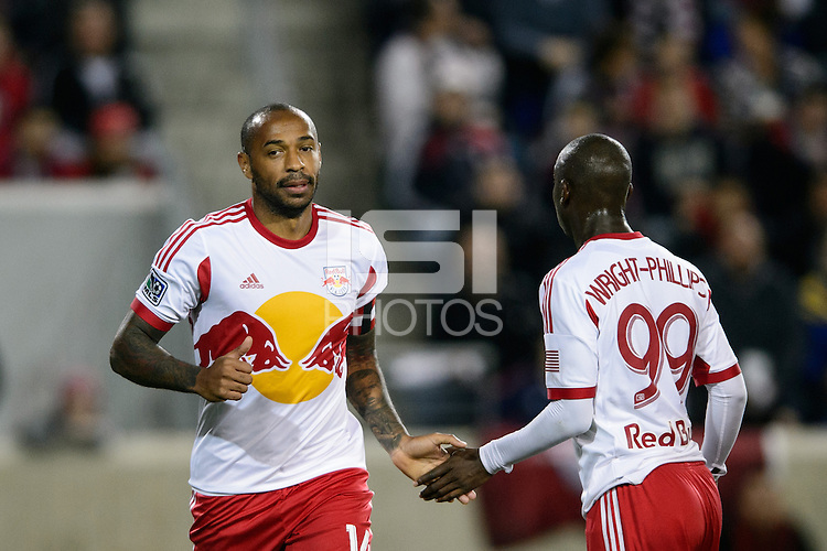 Thierry Henry (14) of the New York Red Bulls low fives with Bradley Wright-Phillips (99). The Houston Dynamo defeated the New York Red Bulls 2-1 (4-3 on aggregate) in overtime of the second leg of the Major League Soccer (MLS) Eastern Conference Semifinals at Red Bull Arena in Harrison, NJ, on November 6, 2013.