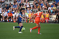 Kansas City, MO - Saturday May 07, 2016: FC Kansas City midfielder Erika Tymrak (15) and Houston Dash defender Ellie Brush (8) during a regular season National Women's Soccer League (NWSL) match at Swope Soccer Village. Houston won 2-1.