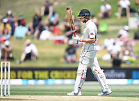 24th November 2019; Mt Maunganui, New Zealand;  Mitchell Santner 50 not out during play on day 4 of the 1st international cricket test match, New Zealand versus England at Bay Oval, Mt Maunganui, New Zealand.  - Editorial Use