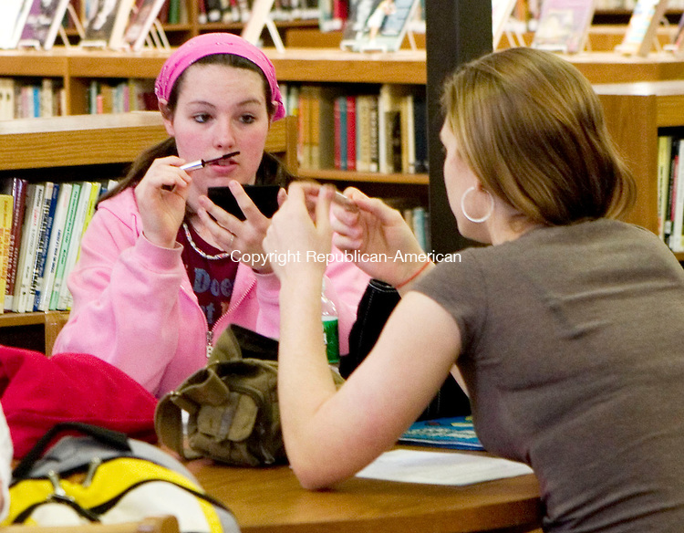 LITCHFIELD, CT- 04 APRIL 07- 040407JT02- <br /> Wamogo High School senior Melissa Gangell, 17, of Goshen, talks to fellow senior Michelle Perna, 18, as they apply makeup as they wait for their turns to audition for MTV's &quot;Made&quot; at the school's library in Litchfield on Wednesday. Gangell wants to become a team roper in a rodeo event and Perna wants to become a motocross biker.<br /> Josalee Thrift Republican-American