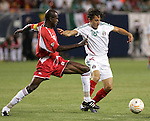 21 June 2007:  Guadeloupe's Alain Vertot (6) challenges Mexico's Jose Andres Guardado (18) for the ball. The National Team of Mexico defeated Guadeloupe 1-0  in a CONCACAF Gold Cup Semifinal match at Soldier Field in Chicago, Illinois.