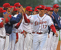 Third baseman Garin Cecchini (17) of the Greenville Drive high-fives teammates as he is introduced prior to a game against the Lakewood BlueClaws on Opening Day, April 5, 2012, at Fluor Field at the West End in Greenville, South Carolina. (Tom Priddy/Four Seam Images)