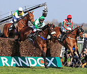 14h April 2018, Aintree Racecourse, Liverpool, England; The 2018 Grand National horse racing festival sponsored by Randox Health, day 3; Richard Johnson leads Thomas Patrick over one of the fences on his way to winning The Betway Handicap Steeple Chase