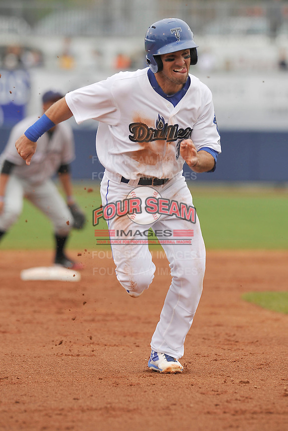 Tulsa Drillers Brandon Trinkwon (16) hustles toward third base during the game against the Northwest Arkansas Naturals at Oneok Field on May 2, 2016 in Tulsa, Oklahoma.  Northwest Arkansas won 9-6.  (Dennis Hubbard/Four Seam Images)