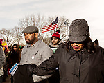 February 11, 2017. Raleigh, North Carolina.<br />  <br /> Reverend James E. Davis III, pastor of Grace AME Zion Church, prays with the crowd before the HKNOJ march kicked off.<br /> <br /> Thousands gathered in downtown Raleigh for the annual HKONJ People's Assembly, a civil rights march tied to the Moral Monday movement. Supporters from around the state gathered to march and speak out against nationwide attacks on civil rights and the Trump administration.<br /> <br /> Jeremy M. Lange for The New York Times