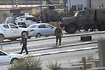 Israeli security forces gather at the scene where a Palestinian man was shot dead by security forces after ramming his car into a group of Israelis at Tapuah junction, south of Nablus in the Israeli-occupied West Bank, on November 8, 2015. A car-ramming attack and a stabbing wounded five Israelis in the West Bank while the two alleged assailants were shot, authorities said, the latest in a weeks-long wave of violence. Photo by Shadi Hatem