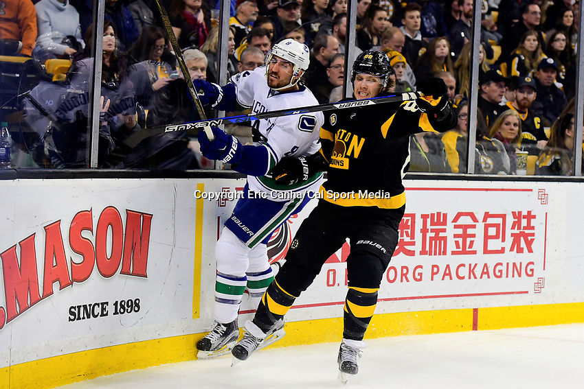 February 11, 2017: Boston Bruins right wing David Pastrnak (88) checks Vancouver Canucks defenseman Christopher Tanev (8) during the National Hockey League game between the Vancouver Canucks and the Boston Bruins held at TD Garden, in Boston, Mass. Boston defeats Vancouver 4-3 in regulation time. Eric Canha/CSM