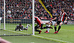 Leon Clarke of Sheffield Utd scores the first goal during the championship match at the Bramall Lane Stadium, Sheffield. Picture date 14th April 2018. Picture credit should read: Simon Bellis/Sportimage