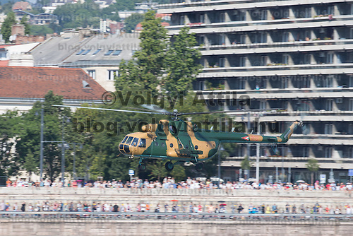 Viewers watch as a Hungarian Air Force Mi-17 fighter helicopter performs above River Danube during an Air show that celebrates Hungarian national holiday on the anniversary of state foundation in Budapest, Hungary  on Aug. 20, 2018. ATTILA VOLGYI
