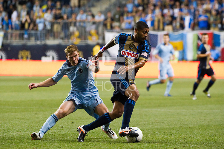 Gabriel Gomez (6) of the Philadelphia Union and Jacob Peterson (37) of Sporting Kansas City. Sporting Kansas City defeated the Philadelphia Union 2-0 during the semifinals of the 2012 Lamar Hunt US Open Cup at PPL Park in Chester, PA, on July 11, 2012.