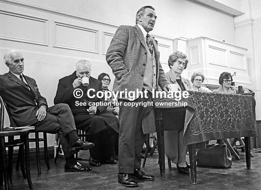 Peace Movement meeting in the Grosvenor Hall, Belfast, N Ireland, being addressed by Harry Murray, former prominent member, Ulster Workers' Council, 25th September 1974. Also on the platform with him were Canon Padraig Murphy, a Roman Catholic priest from West Belfast, Rev Ray Davey, founder, Corrymeela Community, and representatives of the Bogside Peace Committee, Londonderry. 197409250515<br />