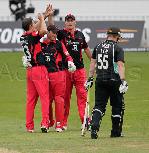 21.08.2012. The Oval, London, England. Rory Hamilton-Brown leaves the field after he is caught behind by Wallace of the bowling of James Harris who are celebrating with Simon Jones during the CB40 match Surrey V Welsh Dragons at The Kia Oval Kennington London England. ..