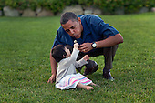 Martha's Vineyard, MA - August 25, 2009 -- United States President Barack Obama plays with his niece Sevita during the family's vacation on Martha's Vineyard, Massachusetts on August 25 2009. .Mandatory Credit: Pete Souza - White House via CNP