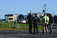 Pictured: Police at the area where climate protesters have blocked access to the Valero refinery causing long queues of traffic in Pembroke Dock, Wales, UK. Thursday 19 September 2019<br /> Re: Ten Extinction Rebellion climate change protesters have blocked three entrances of the Valero site in Pembroke Dock, Pembrokeshire, one of the biggest oil refineries in Europe.<br /> Protesters have attached themselves to wooden boxes filled with concrete in a bit to stop vehicles from entering or leaving the site.