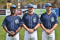 Asheville Tourists coaching staff Paco Martin (7), Warren Schaeffer (13) and Ryan Kibler (9) during media day at McCormick Field on April 4, 2017 in Asheville, North Carolina. (Tony Farlow/Four Seam Images)