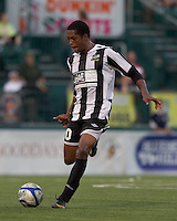 Rochester Rhinos defender TJ Gore (20) passes the ball. In a Third Round U.S. Open Cup match, the Chicago Fire defeated the Rochester Rhinos, 1-0, at Sahlens Stadium on June 28, 2011.