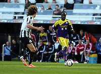 Pictured: Marvin Emnes of Swansea (R) on the attack, against Fabricio Coloccini (L) of Newcastle seconds before he was brought down in the box. Saturday 19 April 2014<br /> Re: Barclay's Premier League, Newcastle United v Swansea City FC at St James Park, Newcastle, UK.