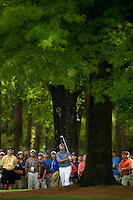 PGA golfer Stewart Cink watches his shot from the rough during the 2008 Wachovia Championships at Quail Hollow Country Club in Charlotte, NC.