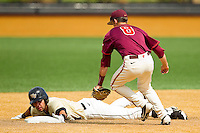 Carlos Lopez #3 of the Wake Forest Demon Deacons slides into second base with a double ahead of the tag attempt by Alex Perez #8 of the Virginia Tech Hokies at Wake Forest Baseball Park on April 21, 2012 in Winston-Salem, North Carolina.  The Demon Deacons defeated the Hokies 8-6.  (Brian Westerholt/Four Seam Images)