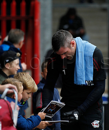 7th October 2017, Glanford Park, Scunthorpe, England; EFL League One football, Scunthorpe versus Wigan; Matthew Gilks of Scunthorpe United signs autographs for young fans before the match