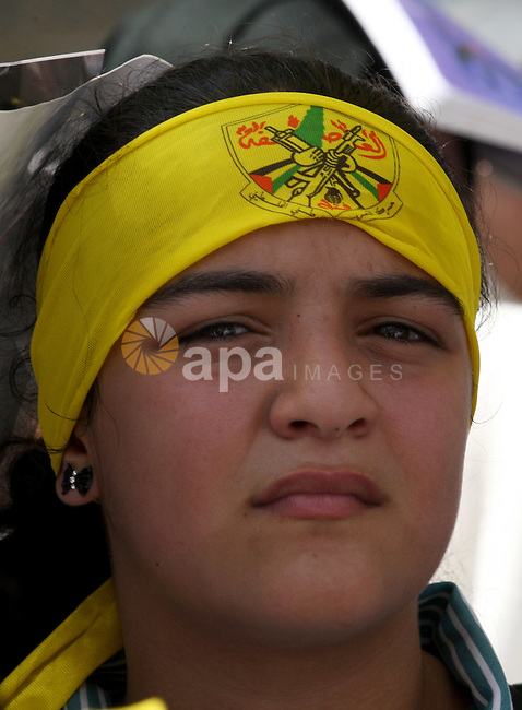 A Palestinian girl takes part in a protest marking the 48th anniversary of the Sabra and Shatila massacre in 1982, in the West Bank city of Nablus, September 16, 2014. The Sabra and Shatila massacre was the slaughter of between 762 and 3,500 civilians, mostly Palestinians and Lebanese Shiites, by the Kataeb Party, a Lebanese Christian militia, in the Sabra neighborhood and the adjacent Shatila refugee camp in Beirut, Lebanon. On 15 September, 63 Palestinian were individually identified and killed by an Israeli unit called Sayeret Matkal, and on 18 September 1982 a more widespread massacre was carried out by a Lebanese Christian Phalangist militia. Photo by Nedal Eshtayah