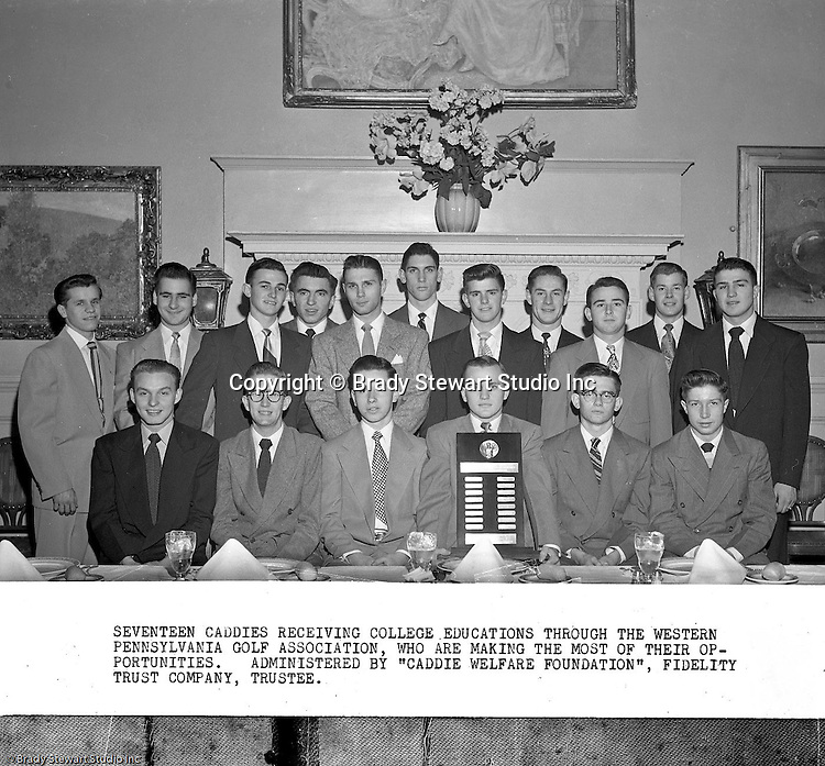 Pittsburgh PA:  View of the Caddies receiving college scholarships from the Western Pennsylvania Golf Association's Caddie Welfare Foundation for year 1951.  The Foundation was managed by Fidelity Trust Company and scholarships are agreed upon by the WPGA executive committee. This dinner was held at the University Club in Pittsburgh and the assignment was for Charles K. Robinson. The mission of the WPGA are to sanction championships, establish handicapping and rate area golf courses.