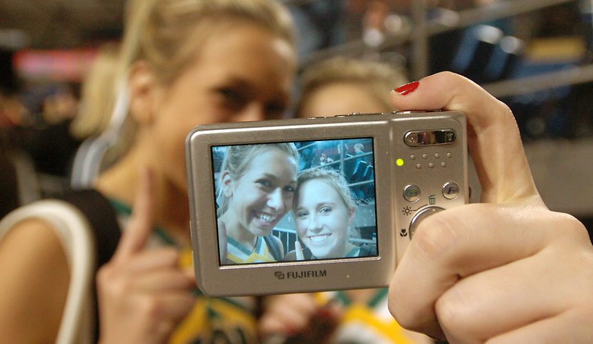 03.10.07 Lynden BBB.******SPORTS********.Lynden cheerleaders Amy Longstreth, left, and Stephanie DeZeeuw take a picture of themselves after the Lynden High School basketball team won the Washington 2A state championship game at the Tacoma Dome in Tacoma, Wash. on Saturday, March 10, 2007. Longstreth and DeZeeuw, both seniors, wanted to document the last day they would be cheering together before moving on to different universities next year.Photo by Danny Gawlowski/The Bellingham Herald
