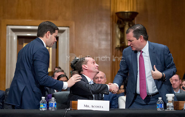 United States Senator Marco Rubio (Republican of Florida), left, and US Senator Ted Cruz (Republican of Texas), right, depart after speaking in support of R. Alexander Acosta, Dean of Florida International University College of Law and United States President Donald J. Trump's nominee for US Secretary of Labor, center, during Acosta's confirmation hearing before the US Senate Committee on Health, Education, Labor &amp; Pensions on Acosta's nomination Capitol Hill in Washington, DC on Wednesday, March 22, 2017.   <br /> Credit: Ron Sachs / CNP /MediaPunch