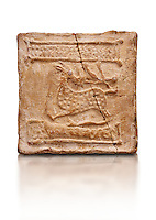 6th-7th Century Eastern Roman Byzantine  Christian Terracotta tiles depicting a stag - Produced in Byzacena -  present day Tunisia. <br /> <br /> The stag is a traditional Christian symbol for Christ, Who tramples and destroys the Devil. In the Medieval bestiaries the stag as an enemy of snakes. It was believed that stags was believed to chase snakes into their holes or rock crevices, driving them out by flooding the hole with the breath or water from its mouth, and eating them. <br /> <br /> These early Christian terracotta tiles were mass produced thanks to moulds. Their quadrangular, square or rectangular shape as well as the standardised sizes in use in the different regions were determined by their architectonic function and were designed to facilitate their assembly according to various combinations to decorate large flat surfaces of walls or ceilings. <br /> <br /> Byzacena stood out for its use of biblical and hagiographic themes and a richer variety of animals, birds and roses. Some deer and lions were obviously inspired from Zeugitana prototypes attesting to the pre-existence of this province's production with respect to that of Byzacena. The rules governing this art are similar to those that applied to late Roman and Christian art with, in the case of Byzacena, an obvious popular connotation. Its distinguishing features are flatness, a predilection for symmetrical compositions, frontal and lateral representations, the absence of tridimensional attitudes and the naivety of some details (large eyes, pointed chins). Mass production enabled this type of decoration to be widely used at little cost and it played a role as ideograms and for teaching catechism through pictures. Painting, now often faded, enhanced motifs in relief or enriched them with additional details to break their repetitive monotony.<br /> <br /> The Bardo National Museum Tunis, Tunisia.  Against a white background.