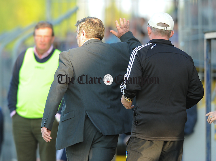 Clare GAA secretary Pat Fitzgerald walks away from Clarecastle manager Roger Mc Mahon during their semi-final against Cratloe at Cusack Park. Photograph by John Kelly.