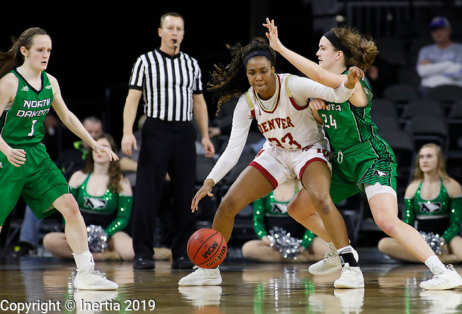 SIOUX FALLS, SD - MARCH 10: Jasmine Jeffcoat #33 from Denver posts up against Julia Fleecs #24 from North Dakota at the 2019 Summit League Basketball Tournament at the Denny Sanford Premier Center in Sioux Falls. (Photo by Dick Carlson/Inertia)