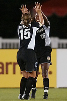 Tiffeny Milbrett celebrates Tammy Pearman's goal against the Carolina Courage. The Courage defeated the Power 2-1 on Wednesday August 7th at Mitchel Athletic Complex, Uniondale, NY.