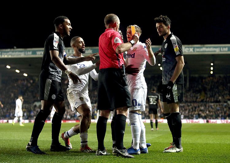 Leeds United's EzgjanAlioski is shown a yellow card by Referee Michael Dean after he went down in the penalty area under the challenge from Reading's Tiago Ilori <br /> <br /> Photographer Rich Linley/CameraSport<br /> <br /> The EFL Sky Bet Championship - Leeds United v Reading - Tuesday 27th November 2018 - Elland Road - Leeds<br /> <br /> World Copyright © 2018 CameraSport. All rights reserved. 43 Linden Ave. Countesthorpe. Leicester. England. LE8 5PG - Tel: +44 (0) 116 277 4147 - admin@camerasport.com - www.camerasport.com