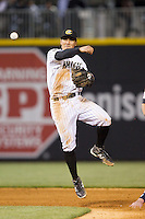 Tyler Saladino (8) of the Charlotte Knights makes a throw to first base against the Gwinnett Braves at BB&T Ballpark on April 16, 2014 in Charlotte, North Carolina.  The Braves defeated the Knights 7-2.  (Brian Westerholt/Four Seam Images)