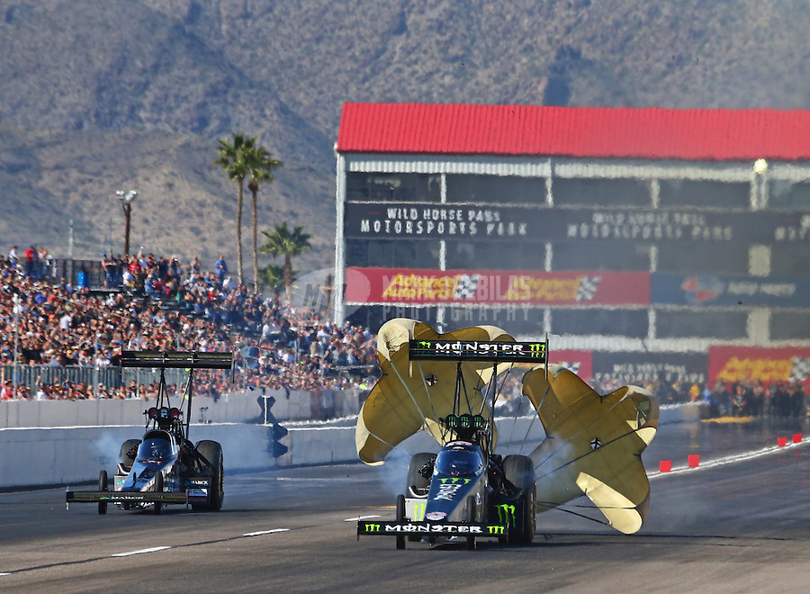 Feb 25, 2017; Chandler, AZ, USA; NHRA top fuel driver Brittany Force (right) deploys her parachutes alongside Scott Palmer during qualifying for the Arizona Nationals at Wild Horse Pass Motorsports Park. Mandatory Credit: Mark J. Rebilas-USA TODAY Sports