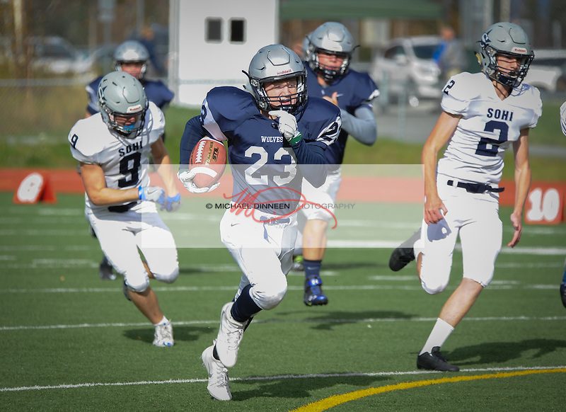 Wolves' running back Grant Burningham escapes for a long first-quarter gain against Soldotna at Eagle River. Photo for the Star by Michael Dinneen