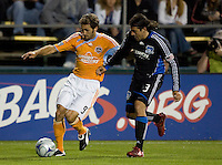 28 March 2009: Brian Mullan of Dynamo dribbles the ball away from Nick Garcia of Earthquakes during the game at Buck Shaw Stadium in Santa Clara, California.  San Jose Earthquakes defeated Houston Dynamo, 3-2.