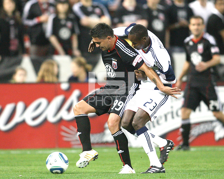 Jaime Moreno #99 of D.C. United is held up by Niouke Desire #23 of the New England Revolution during an MLS match on April 3 2010, at RFK Stadium in Washington D.C.