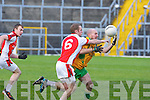 Conor O'Sullivan Rathmore and Mike Murphy Gneeveguilla contest the loose ball during their O'Donoghue cup semi final in Fitzgerald Stadium on Sunday