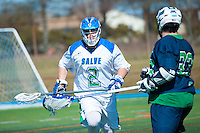Frank Russo,'16, left, defends as the Seahawks battle Endicott in Men's Lacrosse game action at Gaudet Field in Middletown.