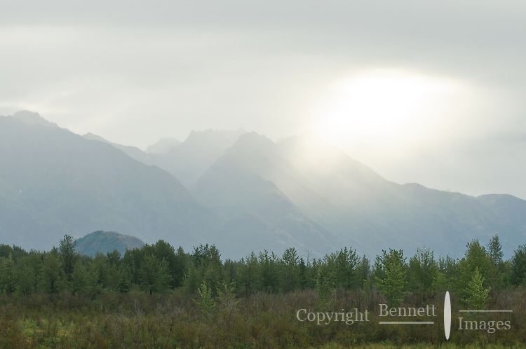 The sun breaks through over the Chugach range as the train moves into the Matanuska Valley heading north.
