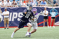 Jack Tigh  (#18) attacks as Yale defeats UAlbany 20-11 in the NCAAA semifinal game at Gillette Stadium, May 26.