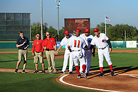 Florida Fire Frogs Ray-Patrick Didder (11) shakes hands with coach Paul Runge (12) during introductions before a game against the Daytona Tortugas on April 6, 2017 at Osceola County Stadium in Kissimmee, Florida.  Also shown is hitting coach Carlos Mendez, coach Tomas Perez, trainer Dave Comeau and other support staff.  Daytona defeated Florida 3-1.  (Mike Janes/Four Seam Images)