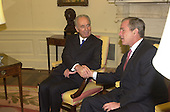 United States President George W. Bush shakes hands with Foreign Minister Shimon Peres of Israel in the Oval Office of the White House. on May 3, 2001<br /> Credit: Ron Sachs / CNP