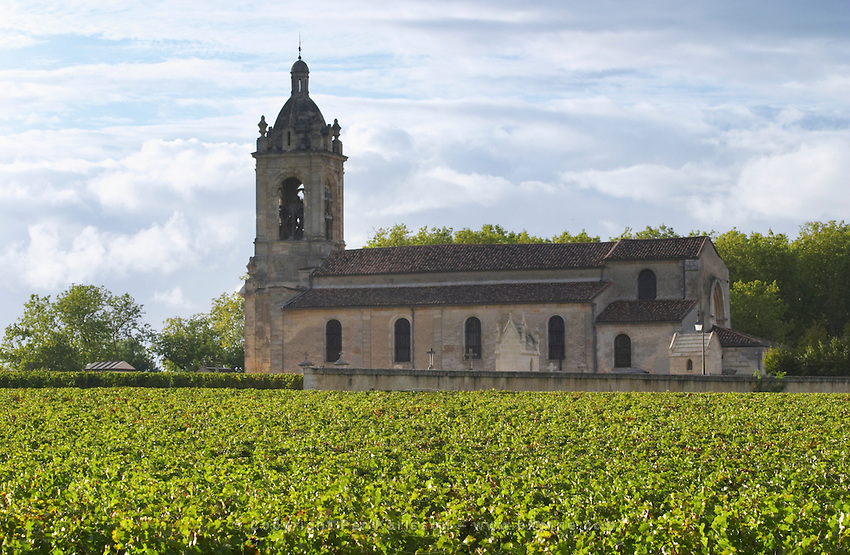 Vineyard and church. Chateau Margaux, Bordeaux, France