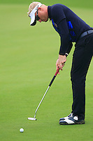 Simon Dyson (ENG) putts on the 9th green during Thursday's Round 1 of the 2014 BMW Masters held at Lake Malaren, Shanghai, China 30th October 2014.<br /> Picture: Eoin Clarke www.golffile.ie