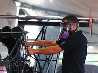 Aug. 2, 2014; Kent, WA, USA; Gary Pritchett , crew member for NHRA top fuel dragster driver Steve Torrence during qualifying for the Northwest Nationals at Pacific Raceways. Mandatory Credit: Mark J. Rebilas-