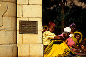 Ujiji, Tanzania. Local women sitting beside the monument where David Livingstone met Henry Moreton Stanley.