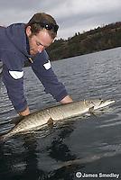 Man holding huge musky fish