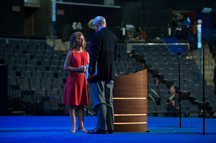 UNITED STATES - September 4 : Rep. Debbie Wasserman Schultz, D-FL., gets some pointers form a stage manager at the Democratic National Convention in the Time Warner Cable Arena in Charlotte, North Carolina. The Democratic National Convention is scheduled to start on Today and run through September 6th. (Photo By Douglas Graham/CQ Roll Call)